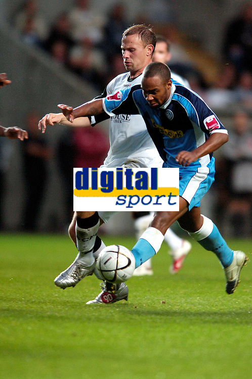 Photo: Adam Davies.<br />Swansea City v Wycombe Wanderers. Carling Cup. <br />Wycombes Jermaine Easter is tackled by Swansea's Kristian O'Leary.<br />22/08/2006.