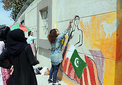 March 27, 2019 - Pakistan - RAWALPINDI, PAKISTAN, MAR 26: Fine art students busy in painting on wall to show their .skills organized by Fatima University, in Rawalpindi on Tuesday, March 26, 2019. (Credit Image: © PPI via ZUMA Wire)