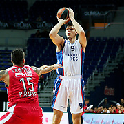 Anadolu Efes's Dario Saric (R) during their Gloria Cup Basketball Tournament match Anadolu Efes between Olympiacos at Ulker Sports Arena in istanbul Turkey on Tuesday 23 September 2014. Photo by Aykut AKICI/TURKPIX