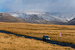 © Licensed to London News Pictures. 01/03/2020. Brecon Beacons National Park, Powys, Wales, UK  A motorist drives along the A4059 in the Brecon Beacons National Park on the first day of meteorological spring, with the summits covered in snow from Storm Jorge which hit Wales yesterday.Photo credit: Graham M. Lawrence/LNP