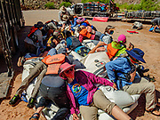 On the last of 16 days boating together for 226 miles, our group laid down on the job of raft deflation, at Diamond Creek on the Hualapai Indian Reservation, Arizona, USA. During this pandemic trip (April 3-18, 2021), masks were required during the initial meeting in Flagstaff, for bus rides, for initial embarkation at Lees Ferry, for serving lines at all meals, and for final disembarkation at Diamond Creek. Otherwise, our healthy outdoor raft trip was unencumbered by facial coverings. For this photo's licensing options, please inquire at PhotoSeek.com.