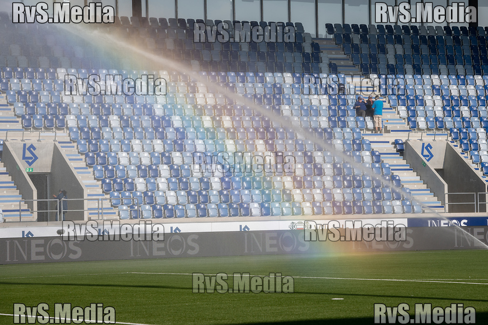LAUSANNE, SWITZERLAND - SEPTEMBER 22: A rainbow appears as water is sprayed on the pitch before the Swiss Super League match between FC Lausanne-Sport and BSC Young Boys at Stade de la Tuiliere on September 22, 2021 in Lausanne, Switzerland. (Photo by Basile Barbey/RvS.Media/)