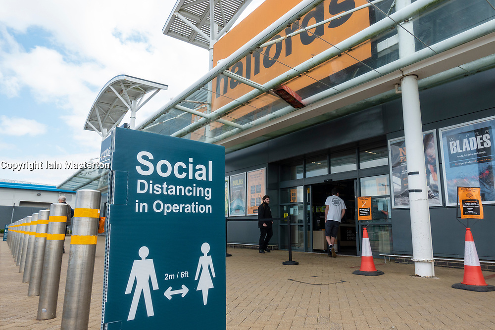 Edinburgh, Scotland, UK. 19 June, 2020. Several shops at Straiton Retail Park outside Edinburgh have opened. Signage warning customers to maintain 2m social distancing is positioned outside and inside shops. Halfords is open with strict rules on entry. Iain Masterton/Alamy Live News