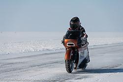 French custom bike builder Bertrand Dubet on his partially streamlined Aprilia RSV4 racer at the Baikal Mile Ice Speed Festival. Maksimiha, Siberia, Russia. Friday, February 28, 2020. Photography ©2020 Michael Lichter.