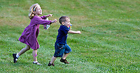 OXFORD, CT - 04 OCTOBER 2009 -100409JT06-.Grace Mahmood, 6, of Oxford, chases her brother Kalled, 2, at the third annual Made in Connecticut Fair at Colonial Tavern in Oxford on Sunday. The fair, which offered fourmet spices, ice cream, jewelry, gifts, maple syrup, and more, was sponsored by the town's Democratic Town Committee..Josalee Thrift Republican-American