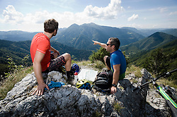 two mountain biker having a rest, Slatnik, Istria, Slovenia
