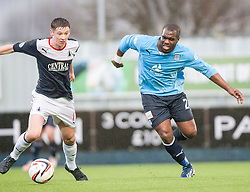 Falkirk's Conor McGrandles and Dundee's Christian Nade.<br /> Falkirk 2 v 0 Dundee, Scottish Championship game at The Falkirk Stadium.<br /> © Michael Schofield.