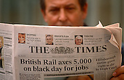 A businessman reads The Times newspaper in the early 90s when the News International title was a broadsheet - before it went to a tabloid format. The headline refers to a British Rail axing of 5,000 jobs, dated Friday 20th November 1992 when it cost just 45 pence. The Times is a British daily national newspaper, first published in London in 1785 under the title The Daily Universal Register (it became The Times on 1 January 1788). The Times and its sister paper The Sunday Times (founded in 1821) are published by Times Newspapers, since 1981 a subsidiary of News International, itself wholly owned by the News Corporation group headed by Rupert Murdoch.