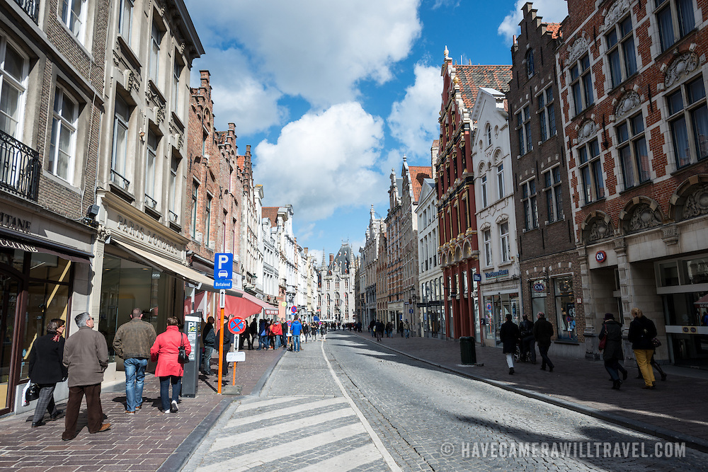 A cobblestone street in the historic center of Bruges.