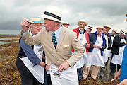 """08/09/2013 Singing to the Oysters<br /> <br /> To help wake the Native Oysters from their beds """"The Brook Singers"""", a male voice choir from Dublin, accompanied by Peter Caviston of Caviston's Food Emporium, (seen here enjoy one of the first of the season straight from the bay )in Glasthule called to Kelly Oysters in inner Galway Bay.<br /> September is a busy month for the Native Oysters which have just come back into season.<br /> The singers will help the oysters prepare for the upcoming Galway international Oyster Festival at the end of the Month . As well as supplying the Oyster Festivals, Kelly Oysters supply oysters throughout Ireland and around the world.<br /> Last season these much sought after delicacies were exported to 14 different countries.   Photo: Andrew Downes"""
