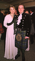 LORD & LADY DALMENY at a ball in London on 30th April 1998.MHI 12
