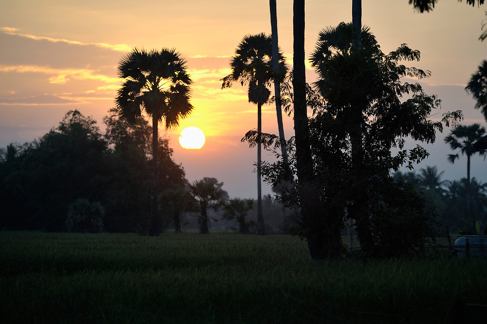 Sunset in Khnach, a village in the Kampot region of Cambodia.