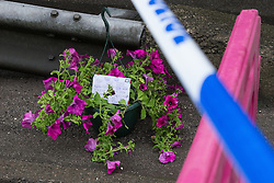 "© Licensed to London News Pictures. 27/07/2015. Salford, UK. Flowers and a tribute at the scene on Manchester Road , Clifton , Salford where Paul Massey - known as Salford's ""Mr Big"" was shot dead last night (26th July 2015 ) . Photo credit: Joel Goodman/LNP"