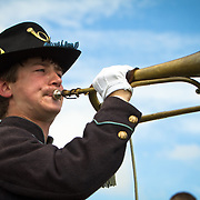 Alan Tobert, 15, of Shippensberg, PA, plays Taps, at the conclusion of the Pickett's Charge Commemorative March, during the Sesquicentennial Anniversary of the Battle of Gettysburg, Pennsylvania on Wednesday, July 3, 2013.  The march was an opportunity to follow in the footsteps of Confederate soldiers by walking with living historians and park rangers along the path of the famously ill-fated Pickett's Charge, which brought to a close The Battle of Gettysburg when the Union Army repelled their advance. Taps was first thought to have been played at a military funeral or memorial service in 1862, at the burial of a Union soldier.  The Battle of Gettysburg lasted from July 1-3, 1863 resulting in over 50,000 soldiers killed, wounded or missing.  John Boal Photography