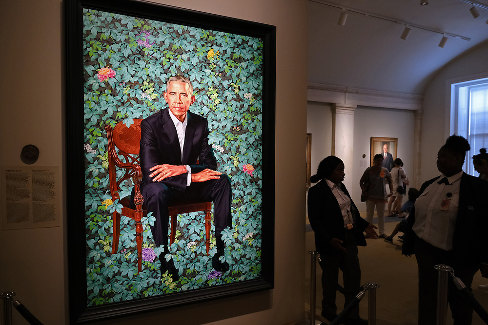 WASHINGTON - JUNE 29, 2019: Visitors look at a painting of the official portrait of President Barack Obama by artist Kehinde Wiley on June 29, 2019, at the National Portrait Gallery in Washington, D.C.