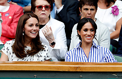 The Duchess of Cambridge and the Duchess of Sussex in the royal box on centre court on day twelve of the Wimbledon Championships at the All England Lawn Tennis and Croquet Club, Wimbledon.