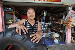 The owner of a shop selling household and farming goods, she is now building additional space to expand her thriving business,  Ban Phonthong, Bolikhamsay Province Lao PDR