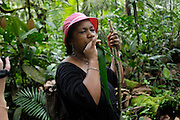Ecuador, May 7 2010: Lorna Brooks attempts to produce a toucan's call using a rolled leaf. Copyright 2010 Peter Horrell