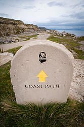 Stone Coast Path sign on the Isle of Portland, Dorset, England, UK.