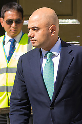 Whitehall, London, July 31st 2015. Business Secretary Sajid Javid leaves the Cabinet Office following a COBRA meeting to discuss the ongoing refugee crisis in Calais which is seeing continual disruption to Channel Tunnel services, one of the UK's most important cross border routes.