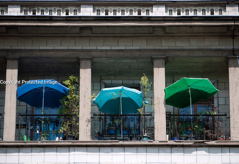 Summer parasols on balconies of old apartment buildings on Karl Marx Allee in Berlin Germany