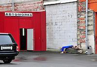 Lunch break at the luxury car garage, St. Petersburg, Russia.