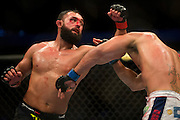 Johny Hendricks throws a punch at Robbie Lawler during UFC 171 in Dallas, Texas on March 15, 2014.
