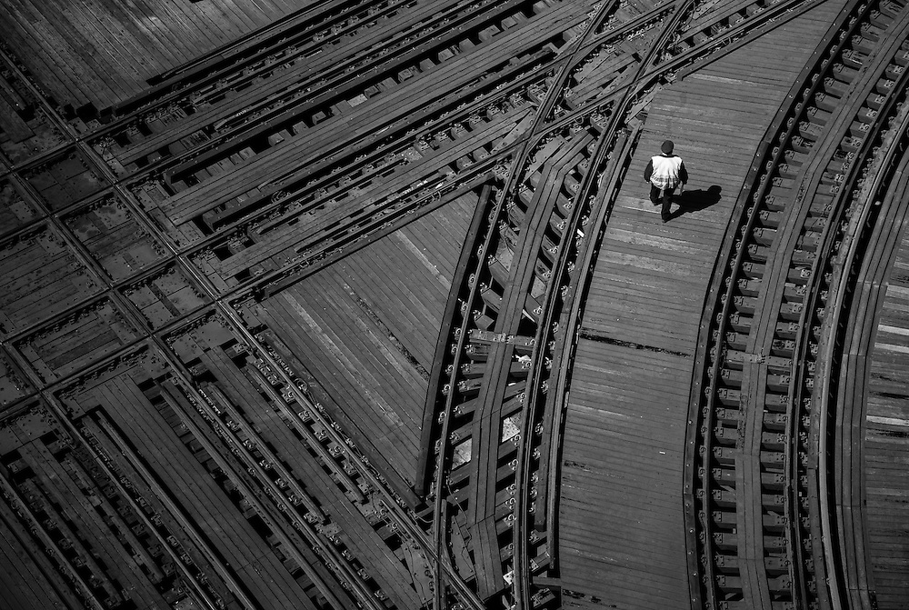 The CTA operator at Junction 18 carefully moves thru the maze of tracks on his way to the tower.