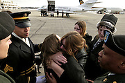 Kathleen Harrington (mother) and Faith Harrington (wife) seek comfort in each other as the plane with the body of Sgt. Kyle J. Harrington arrives at TFG.  Family members of Sgt. Kyle J. Harrington, 24, who was killed in an accident in Iraq wait for his body to arrive at TFG airport in Providence.  It was then brought to Birchcrest Home of Waring-Sullivan in Swansea where family members had a few minutes with the casket.  Army Sgt. Kyle J. Harrington 24, of Swansea, Mass.; was assigned to the 542nd Maintenance Company, 80th Ordnance Battalion, 593rd Sustainment Brigade, Fort Lewis, Wash.; died Jan. 24 in Basra, Iraq, of injuries sustained from a non-hostile accident in his unit motor pool.
