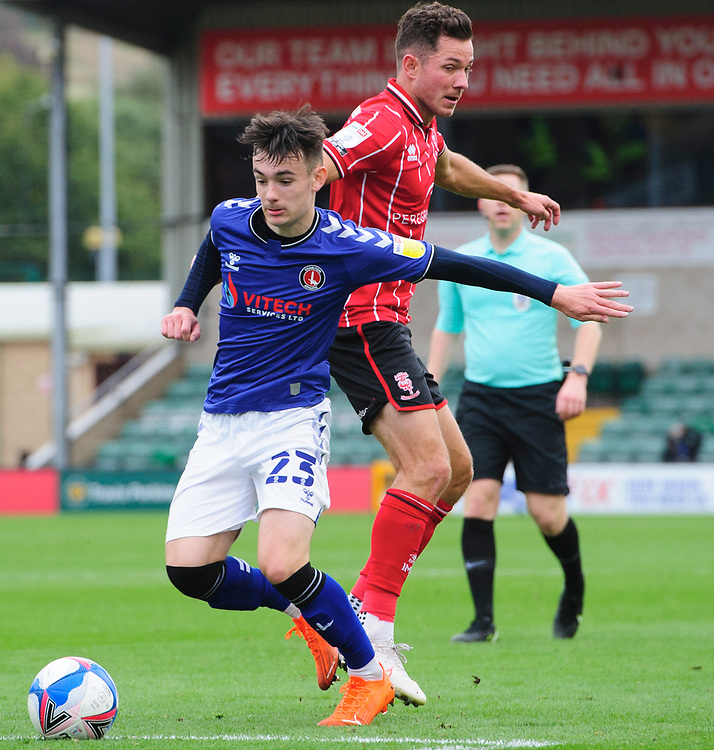 Charlton Athletic's Dylan Levitt vies for possession with Lincoln City's Tom Hopper<br /> <br /> Photographer Chris Vaughan/CameraSport<br /> <br /> The EFL Sky Bet League One - Lincoln City v Charlton Athletic - Sunday 27th September, 2020 - LNER Stadium - Lincoln<br /> <br /> World Copyright © 2020 CameraSport. All rights reserved. 43 Linden Ave. Countesthorpe. Leicester. England. LE8 5PG - Tel: +44 (0) 116 277 4147 - admin@camerasport.com - www.camerasport.com