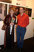 Will Ramsay and Samantha Bond, The Affordable Art Fair private view ( in aid of Barnados) Battersea. 19 March 2003. © Copyright Photograph by Dafydd Jones 66 Stockwell Park Rd. London SW9 0DA Tel 020 7733 0108 www.dafjones.com