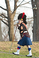 West Point, New York - The drum major from the Leatherneck Pipes and Drums walks away from the field at the end of the 32nd annual West Point Military Tattoo at Trophy Point at the United States Military Academy on April 13, 2014.