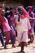 Indian youths celebrating annual Hindu Holi festival of colours with powder paints at beach party in Mumbai, formerly Bombay, India