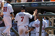 Joe Mauer #7 of the Minnesota Twins is congratulated by his teammates after scoring against the Seattle Mariners on June 2, 2013 at Target Field in Minneapolis, Minnesota.  The Twins defeated the Mariners 10 to 0.  Photo: Ben Krause