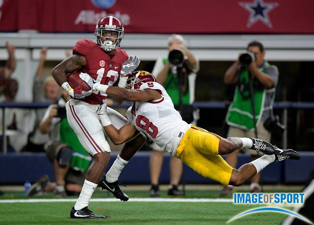 Sep 3, 2016; Arlington, TX, USA; Alabama Crimson Tide wide receiver ArDarius Stewart (13) catches a touchdown pass past USC Trojans defensive back Iman Marshall (8) during the second quarter at AT&T Stadium.