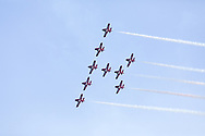 Canadian Forces Snowbirds in a Wineglass formation with smoke.  The Snowbirds are also known as the 431 Air Demonstration Squadron and fly the Canadair CT-114 Tutor jet. Photographed during the Canada 150 celebrations in White Rock, British Columbia, Canada.