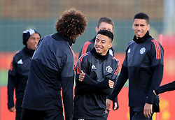 Manchester United's Jesse Lingard has a jokes with Manchester United's Marouane Fellaini during the training session at the AON Complex, Carrington.