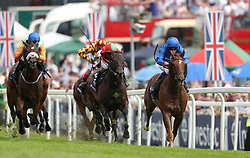 G K Chesterton ridden by William Buick (right) before winning the Investec Click & Invest Mile Handicap on Ladies Day during the 2017 Investec Epsom Derby Festival at Epsom Racecourse, Epsom.