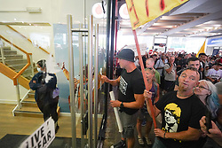 © Licensed to London News Pictures. 24/07/2021. Manchester, UK. Protesters try to storm a Covid-19 testing centre in Manchester City centre  during an anti-lockdown protest. Photo credit: Ioannis Alexopoulos/LNP