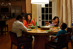 The Perkins family have dinner in the home, Silver Spring, Md., Sept. 12, 2011.