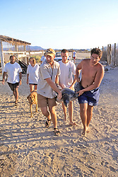 J. & Tony & Ryan Carrying Black Sea Turtle