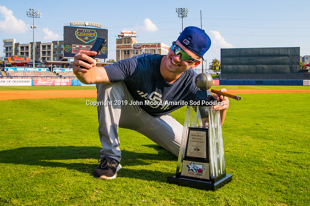 Amarillo Sod Poodles pitcher Aaron Leasher (32) poses with the trophy after the Sod Poodles won against the Tulsa Drillers during the Texas League Championship on Sunday, Sept. 15, 2019, at OneOK Field in Tulsa, Oklahoma. [Photo by John Moore/Amarillo Sod Poodles]