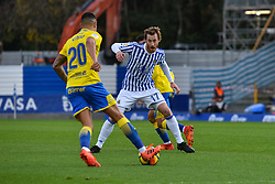 November 26, 2017 - San Sebastian, Gipuzkoa - Basque Country, Spain - Vitolo of U D Las Palmas duels for the ball with Zurutuza of Real Sociedad during the Spanish league football match between Real Sociedad and U D Las Palmas at the Anoeta Stadium on 26 November 2017 in San Sebastian, Spain  (Credit Image: © Jose Ignacio Unanue/NurPhoto via ZUMA Press)