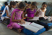 Indian children learning English at Rajyakaiya School in Narlai village, Rajasthan, Northern India