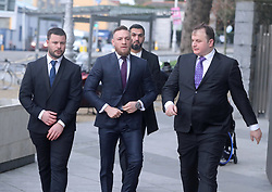 Conor McGregor (centre) arrives at Dublin District Court where he is charged with motoring offences.