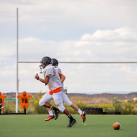 081413       Cable Hoover<br /> <br /> The Gallup Bengals football jogs across their practice field as they prepare for the 2013 season Wednesday at Gallup High School.