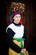 Lena, member of the Trachtengruppe Glasofen, is wearing a traditional bridal costume in Glasofen, Lower Franconia in Germany on March 4th, 2017.<br /> <br /> The bridal crown and necklace are original and from 1860 and 1850. After the WWII, the association was formed and to preserve the traditional costumes, the members crafted original copies.<br /> Glasofen is part of the Wertheim Shire, an evangelical area surrounded by catholic Hinterland.<br /> <br /> This is part of the series about Traditional Wedding Gowns from different regions of Germany, worn by young members of local dance groups and cultural associations that exist to preserve and celebrate the cultural heritage. The portraiture series is a depiction of an old era with different social values and religious beliefs in an antiquated civil society with very few of those dresses left.