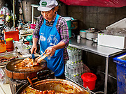 20 SEPTEMBER 2018 - BANGKOK, THAILAND:  Making stewed pork leg. Street food venders of Sukhumvit Soi 16 in Bangkok.    PHOTO BY JACK KURTZ