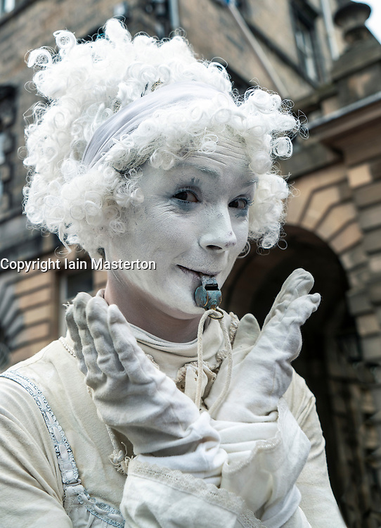 Edinburgh, Scotland, UK; 5 August, 2018. Edinburgh Fringe Festival's first weekend sees thousands of tourists and locals on the Royal Mile  enjoying the free street performers. Pictured; Street performer Lady Whistle