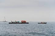tugboat transporting cement trucks Tokyo bay Yokosuka Japan